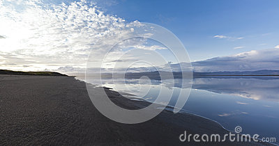 Black Sand Beach At The Icelandic River Olfusa Stock Photo.