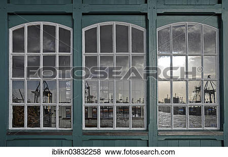 """Pictures of """"Reflection of a harbour scene in an old boat shed."""