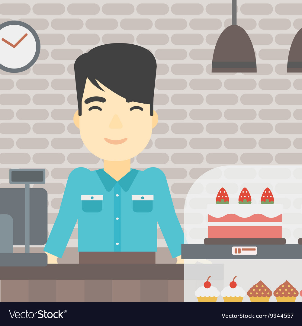 Worker standing behind the counter at the bakery.