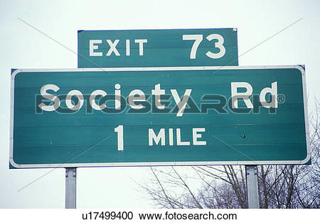"Stock Photography of A sign that reads ""Society Rd 1 mile."