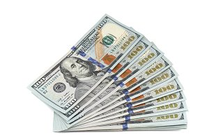 Stack of new 100 dollar bills.