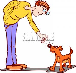 Man Giving His Dog a Treat.