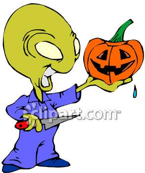 An Alien Holding A Jack O Lantern.