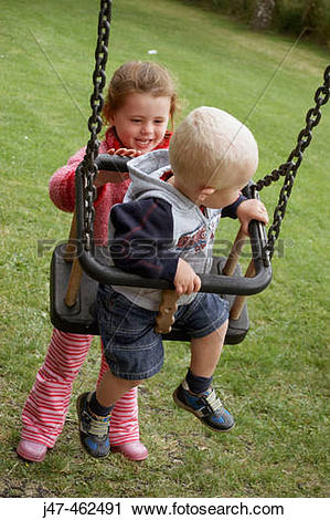 Stock Photography of 3 year old girl pushing and 18 month old boy.