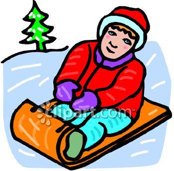 Child Sledding in Winter.