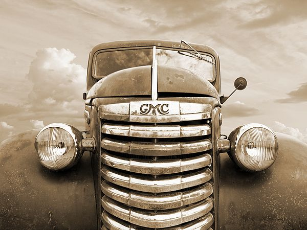 A rusty old GMC Pickup truck from 1939 or 1940 in sepia.