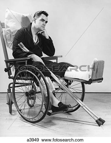 Stock Photograph of 1940S Man In Wheelchair With Cast On Left Leg.