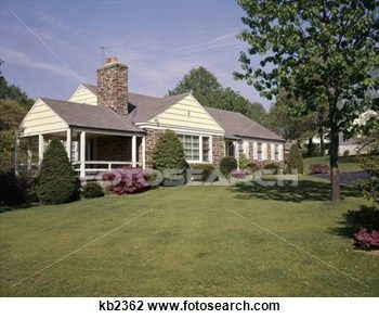 1950s 1960s stone ranch style house home nice lawn side.