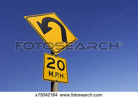 Stock Photo of Yellow '20 MPH' speed limit and arrow sign, low.