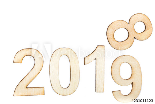 2018 to 2019 year celebrate with wooden numbers on white.