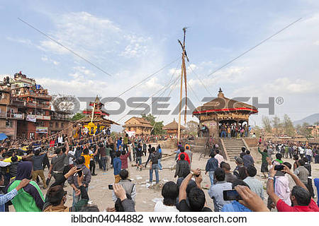 """Stock Photo of """"A 25m high pole or lingam is pulled to the ground."""