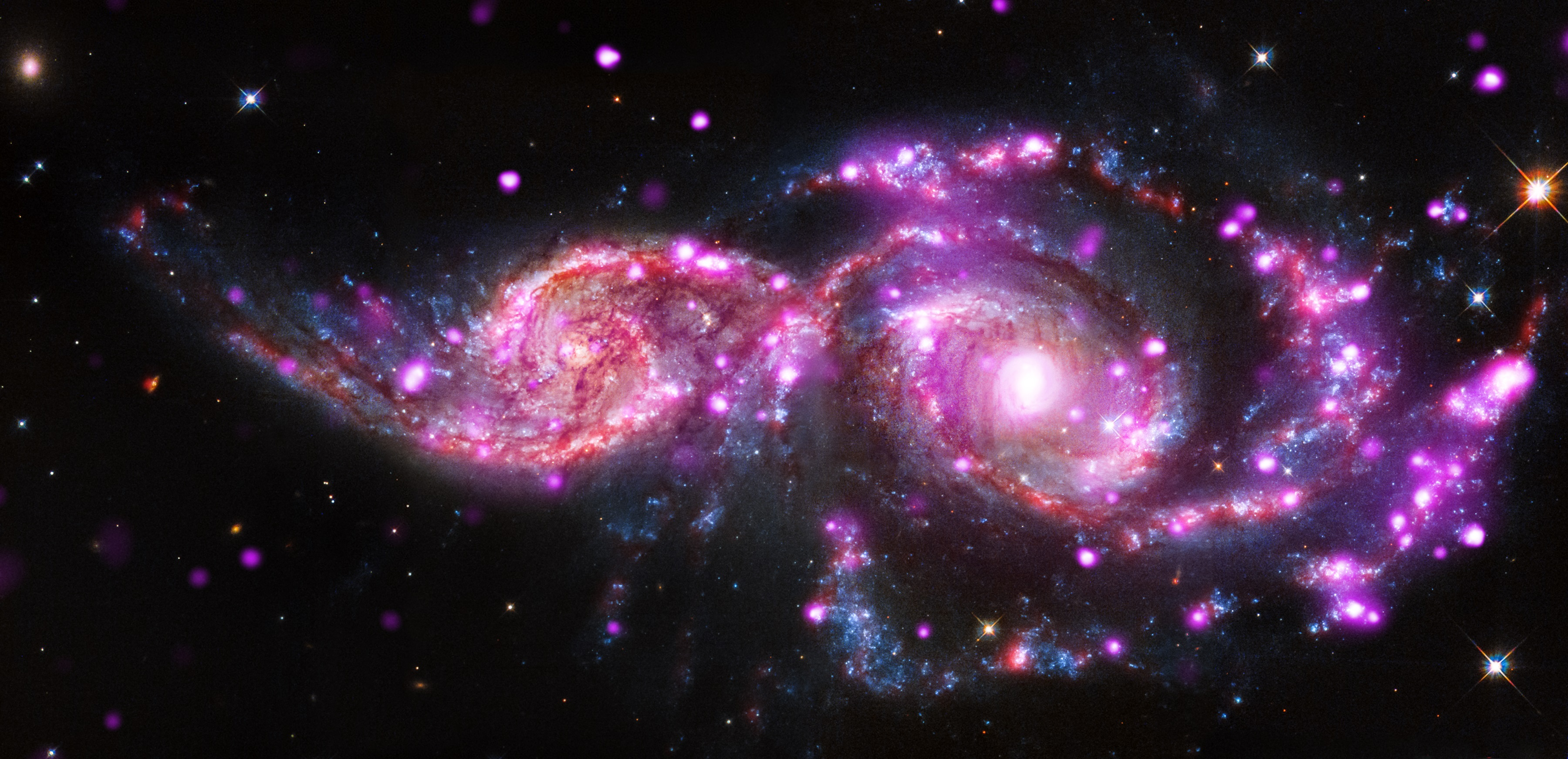 Clipart of colliding spiral galaxies free image.