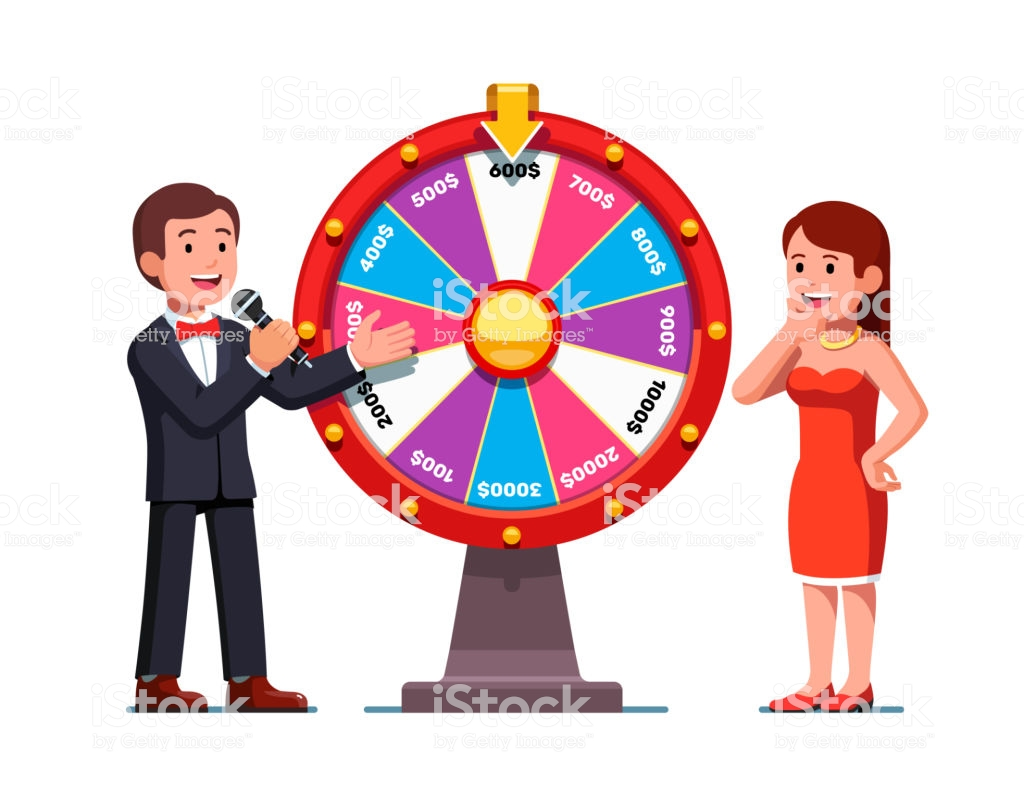 Smiling Woman Playing Wheel Of Fortune On Game Show With Host Man.