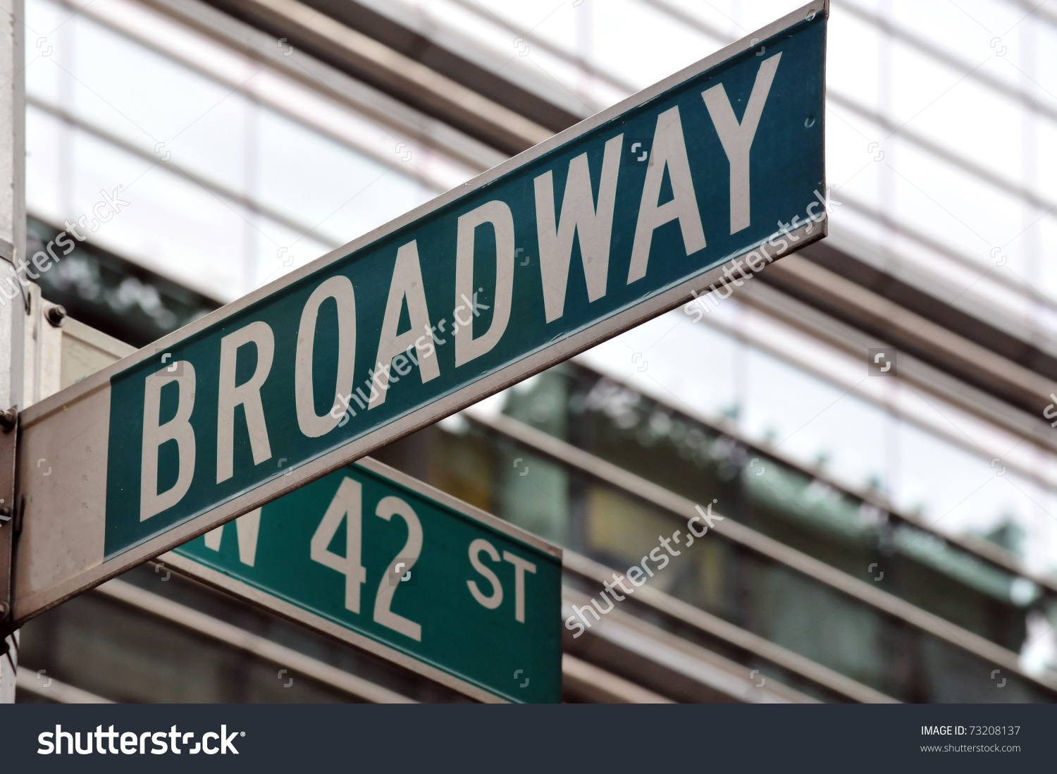 Street Sign On Corner Broadway 42nd Stock Photo 73208137.