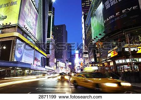 Stock Photograph of City lit up at night, 42nd Street, Times.