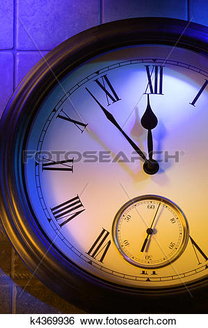 Stock Images of Mysterious clock shows 5 minutes to midnight.