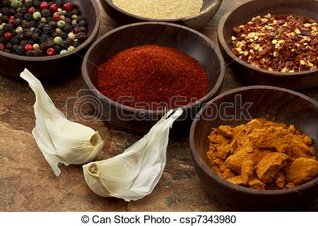 Stock Photography of Spices in wooden bowls.