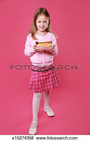 Pictures of 5 year old girl holding a tray with a hot dog and.