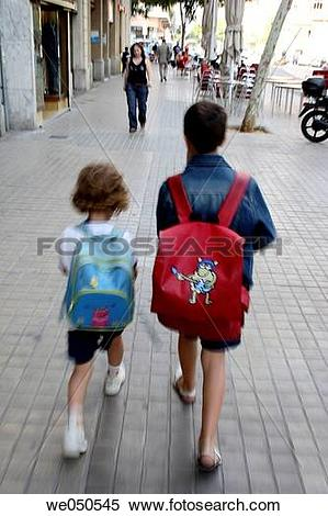 Stock Image of 9 and 5 year old boy and girl going to school.