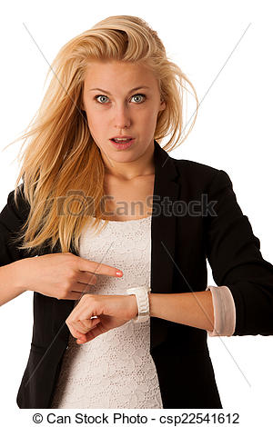 Stock Photography of Young blonde woman looks at her watch when.