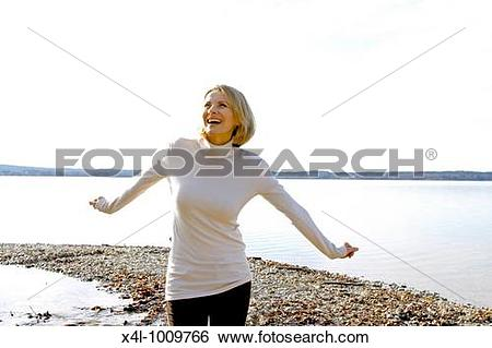 Stock Images of blonde woman in the late fall at a lake x4l.