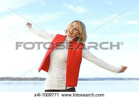 Stock Photography of blonde woman in the late fall at a lake x4l.