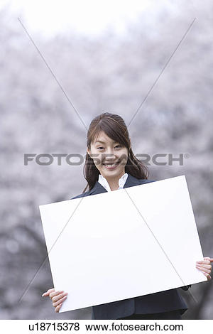Pictures of Businesswoman Holding a White Board, Head and Shoulder.