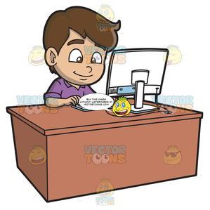 A Boy Using A Desktop Computer.
