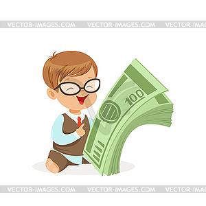 Cute boy businessman holding stack of money, kids.