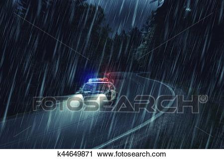 USA police car at work at night in the forest, heavy rain.