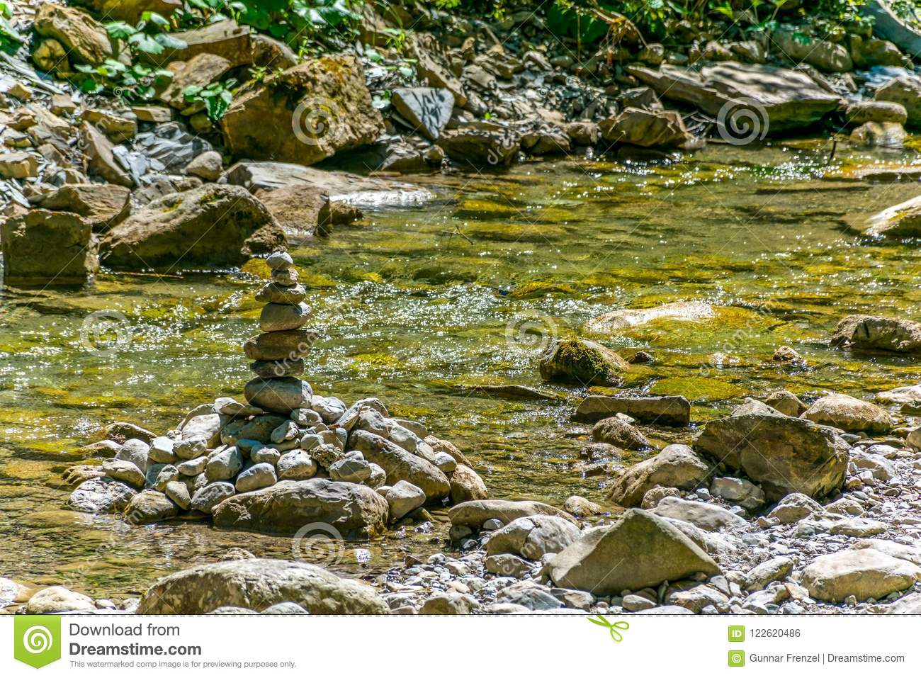 Small Creek With Stone Bed In Sunhine Stock Photo.
