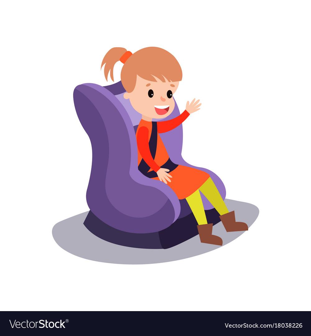 Cute little girl sitting on a purple car seat.