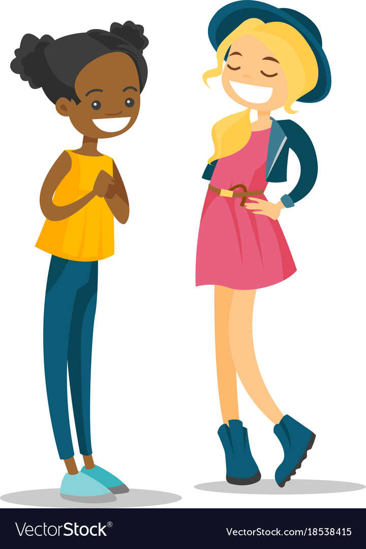 Two young multiracial girls talking and laughing.