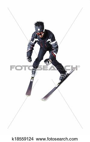Stock Photo of One male skier skiing without sticks on a white.