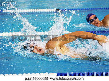 Stock Image of Male swimmers swimming freestyle in pool, close.