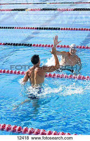 Pictures of Two young male swimmers giving high.
