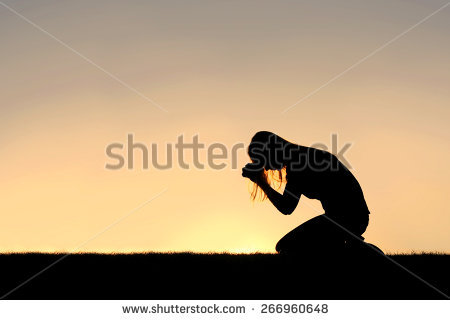 Kneeling In Prayer Stock Images, Royalty.