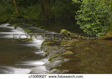 Picture of England, Derbyshire, Dovedale, A small waterfall on the.