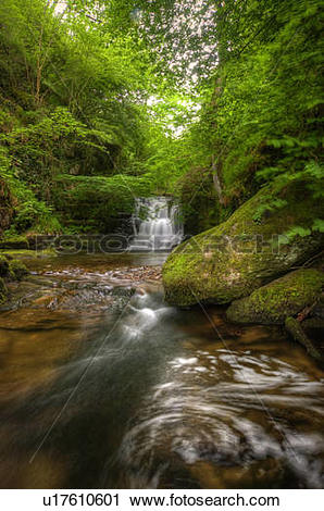 Stock Photography of England, Devon, Watersmeet. A small waterfall.