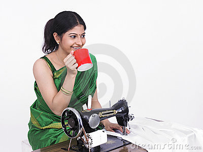Asian Female Tailor Drinking Tea Stock Photo.