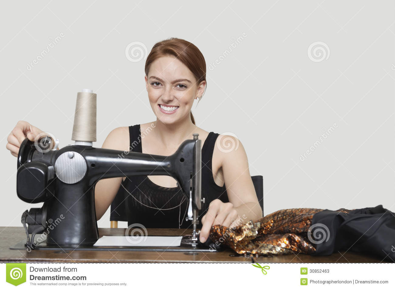 Tailor With Sewing Machine Clipart.