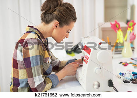 Stock Photo of Tailor woman working with sewing machine k21761652.
