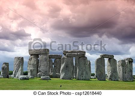 Stock Photo of Stonehenge historic site on green grass under cloud.