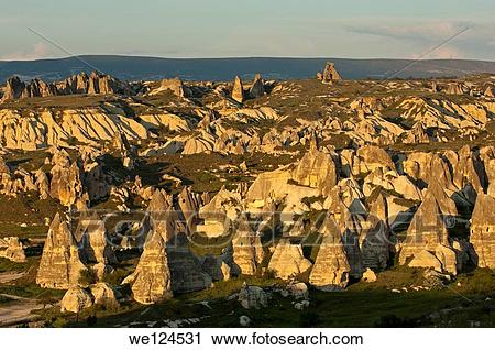 Stock Photography of Landscape with eroded tuff rock formations.