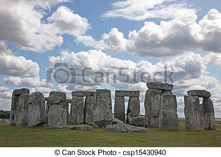 Stock Photo of Stonehenge historic site on green grass under blue.