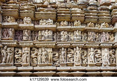 Stock Photograph of Stone carved erotic bas relief in Hindu temple.