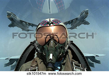 Stock Photo of A pilot takes a self portrait from the cockpit of.