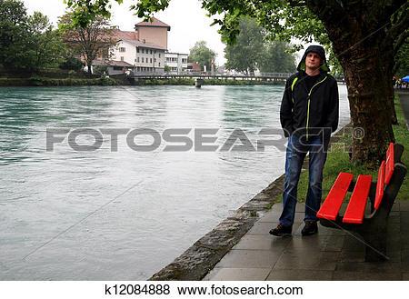 Pictures of Man near river Aare Interlaken Switzerland k12084888.