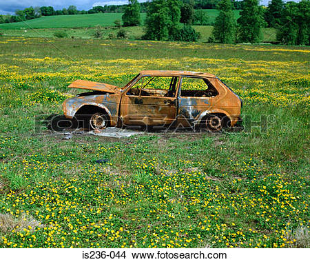 Stock Photo of Abandoned car in a field is236.