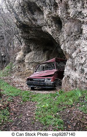 Stock Illustration of abandoned car in a cave csp9287140.